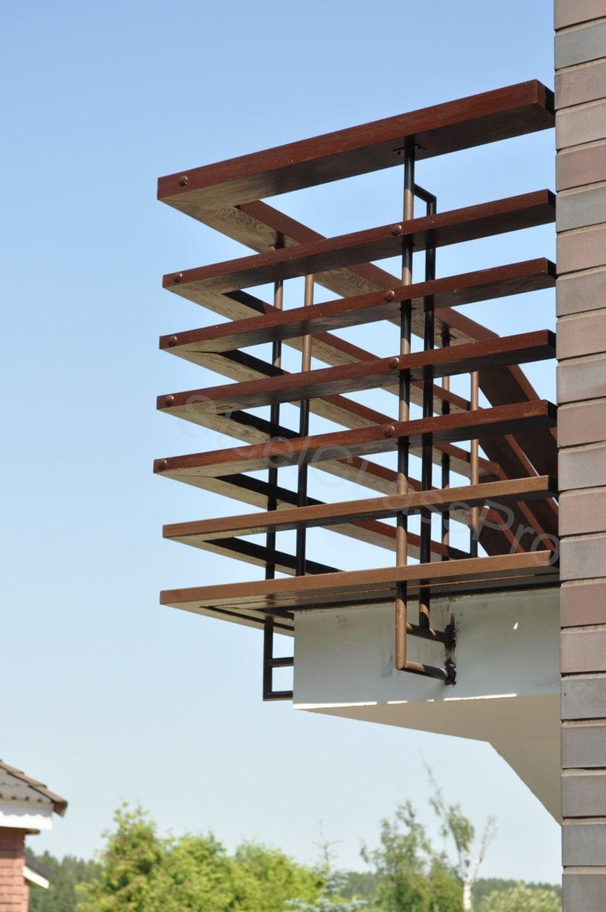 Ограждение балкона из дерева своими руками